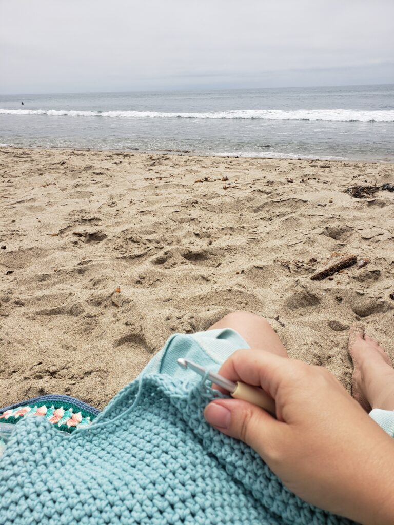 Relaxing with crochet by the beach